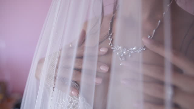 young bride puts on her jewelry - pearl jewellery stock videos & royalty-free footage