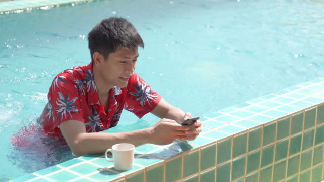 young business asian men using digital tablet and smart phone do their work at home and relax with online shopping in his vocations - southeast asian ethnicity stock videos & royalty-free footage