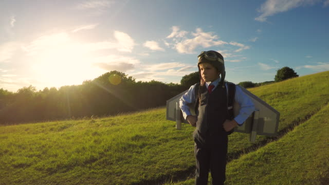 young business boy with jet pack in england - boys stock videos & royalty-free footage