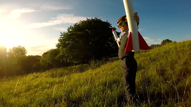 young business boy with rockets in england - astronaut stock videos & royalty-free footage