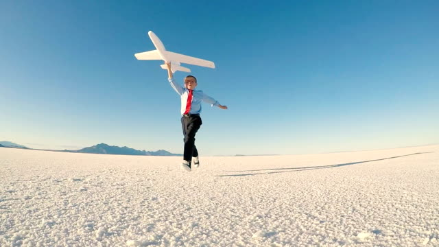 young business boy with toy airplane - innovation stock videos & royalty-free footage
