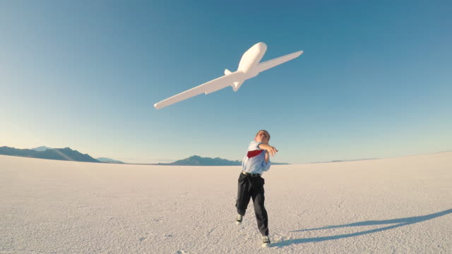 young business boy with toy airplane - lanciare video stock e b–roll