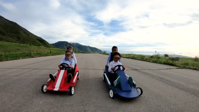 young business children race go carts - go cart stock videos & royalty-free footage