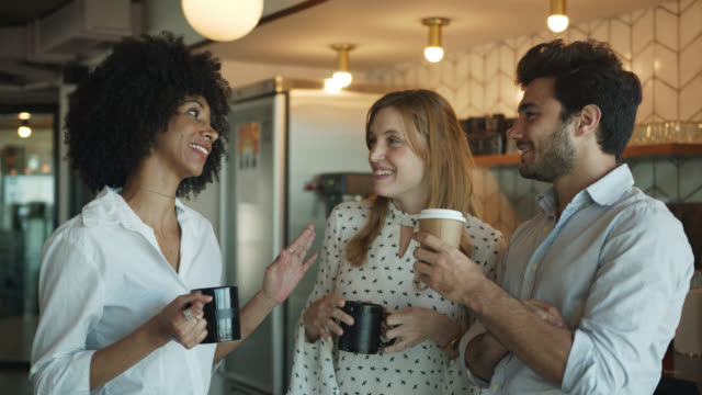 young business colleagues having fun taking a break at the office self service cafeteria while talking and smiling - coffee variation stock videos & royalty-free footage