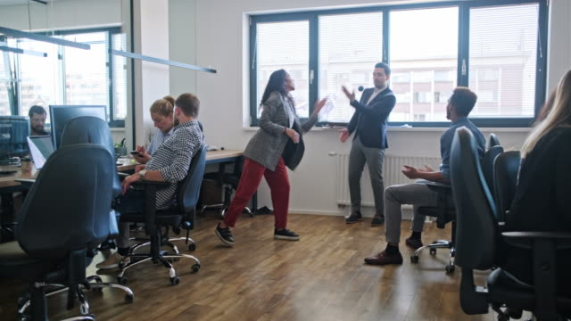 young business coworkers having fun in the office - employee engagement stock videos & royalty-free footage