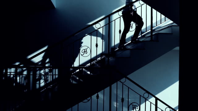 Young business man climbing stairs