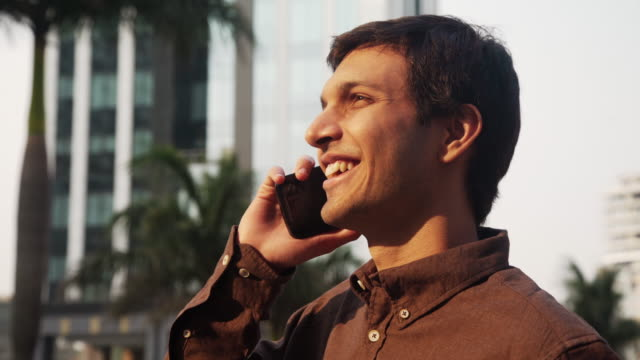 young business man in india taking by cellphone - south asia stock videos & royalty-free footage