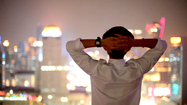 Young business man look to cityscape, asian