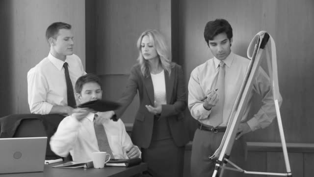 young business man making presentation to coworkers - three quarter length stock videos & royalty-free footage