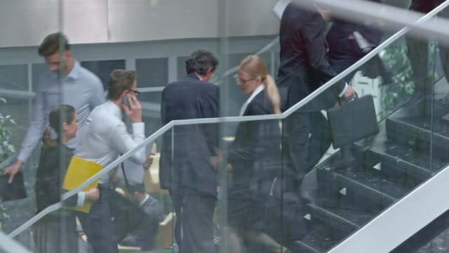 ds young business man overpassing people up the stairs - suit stock videos & royalty-free footage