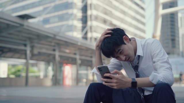 young business man overworked, sitting looking down very sad - struggle stock videos & royalty-free footage