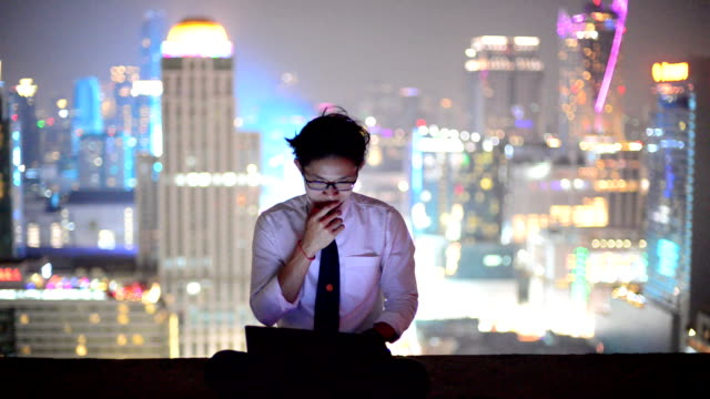 young business man using laptop and look to cityscape, asian - chinese ethnicity stock videos & royalty-free footage