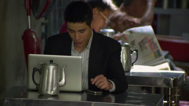 ms young business man using laptop sitting in outdoor restaurant, bangkok, ayuthaya, thailand - see other clips from this shoot 1448 stock videos and b-roll footage
