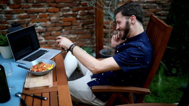 young business man using phone and laptop outdoors - over eating stock videos & royalty-free footage
