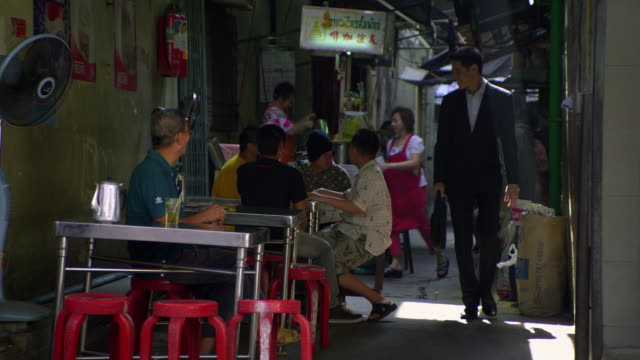 ms young business man walking through alley with restaurants bangkok, ayuthaya, thailand - see other clips from this shoot 1448 stock videos and b-roll footage