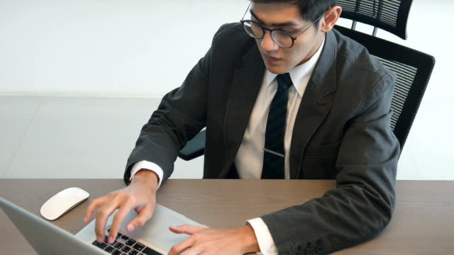 Young Business Man Working At The Office