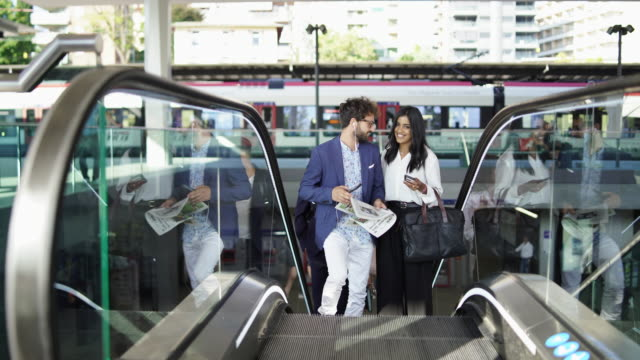young business men and women arrive at train station - ticino canton stock videos and b-roll footage