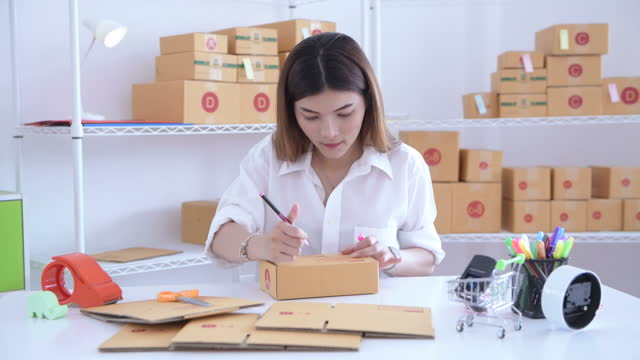 young business owner home office, online marketing packaging box and delivery e-commerce with happiness - selling stock videos & royalty-free footage