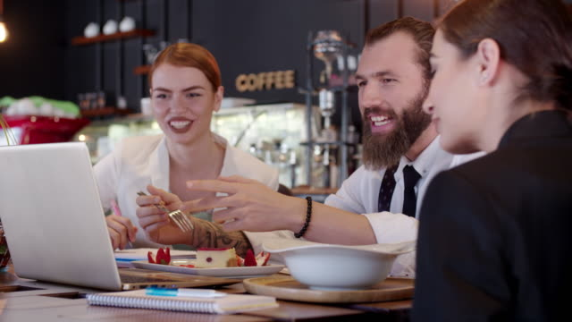 Young business people at the restaurant