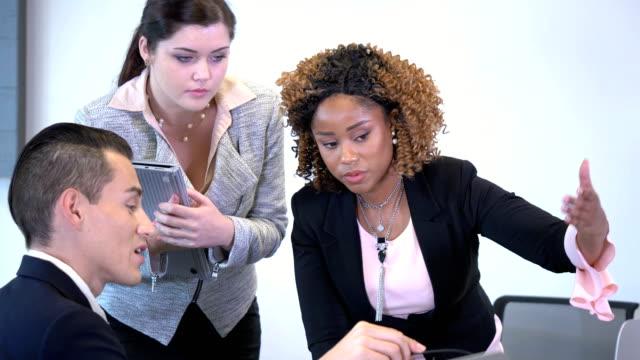 young business people in meeting, having a debate - three people stock videos & royalty-free footage