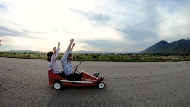 young business team of children go cart race - wishing stock videos & royalty-free footage