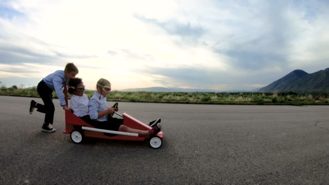 young business team of children go cart race - opportunity stock videos & royalty-free footage