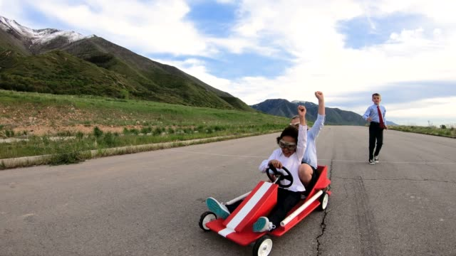 young business team of children go cart race - aspirations stock videos & royalty-free footage