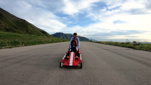 young business team races a go cart - colleague stock videos & royalty-free footage
