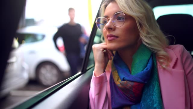 young business woman riding in back seat in the taxi - taxi stock videos & royalty-free footage