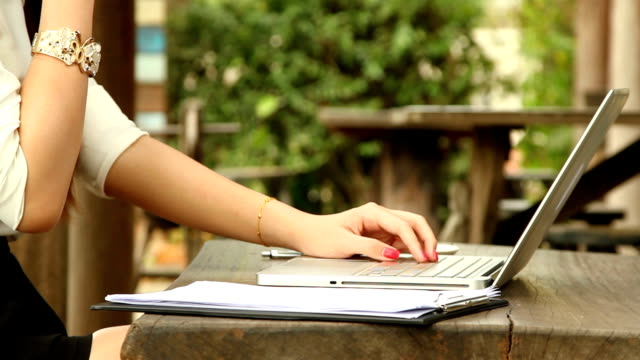 Young business woman typing on laptop