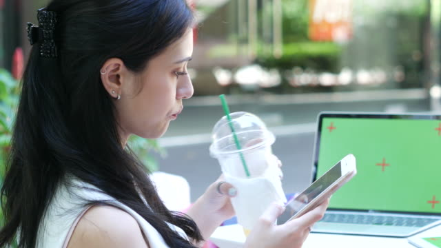 young business woman using phone and drinking cold coffee - hot desking stock videos & royalty-free footage