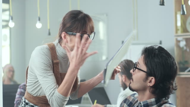young business woman yelling at colleague - blame stock videos and b-roll footage