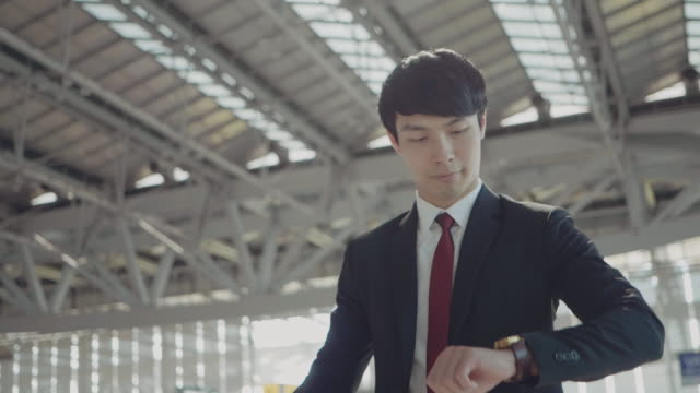 young businessman at an airport. - chinese ethnicity stock videos & royalty-free footage