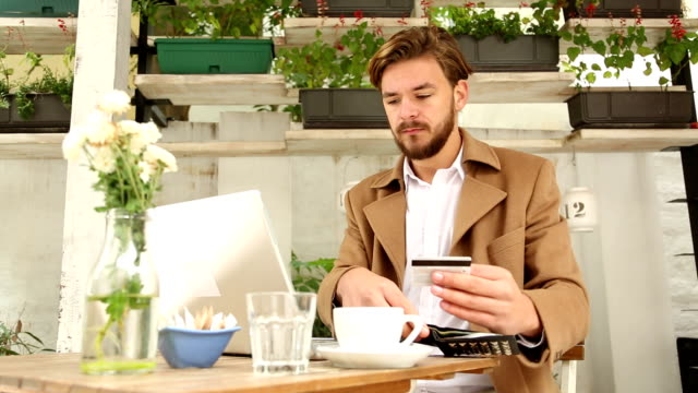 young businessman at cafe - coffee table stock videos & royalty-free footage