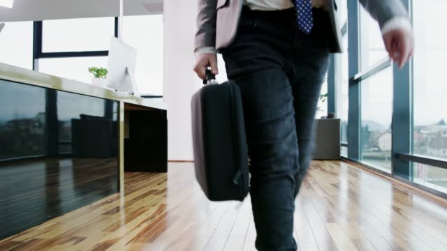 young businessman boy walking with briefcase in office, real time - adult imitation stock videos & royalty-free footage