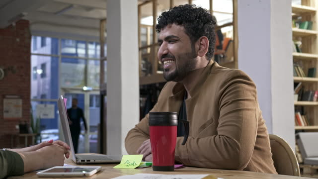 young businessman chatting with colleague over coffee - beard stock videos & royalty-free footage