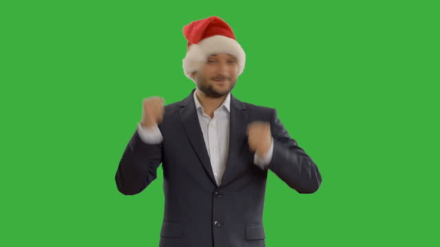 young businessman dancing in a hat santa claus - santa hat stock videos & royalty-free footage