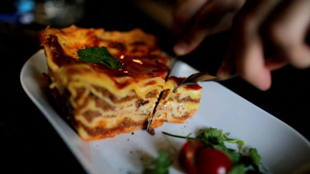 young businessman eating lasagna in restaurant - lasagna stock videos & royalty-free footage