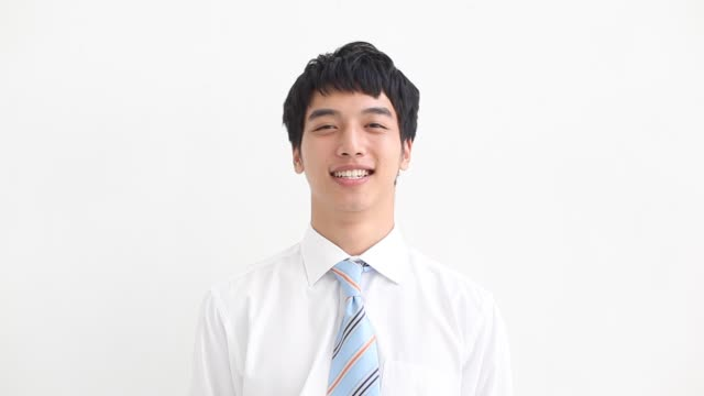 vidéos et rushes de young businessman expression - chemise et cravate