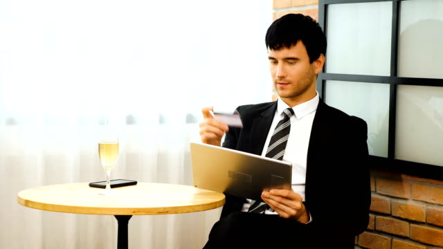 young businessman holding credit card and using digital tablet at cafe, online shopping and concept - 35 39 years stock videos & royalty-free footage