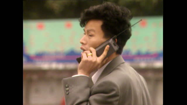 ms young businessman in suit talking on mobile phone; 1996 - 1996 stock videos & royalty-free footage