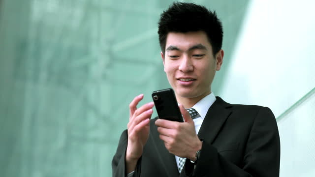 young businessman on a mobile phone - portability stock videos and b-roll footage