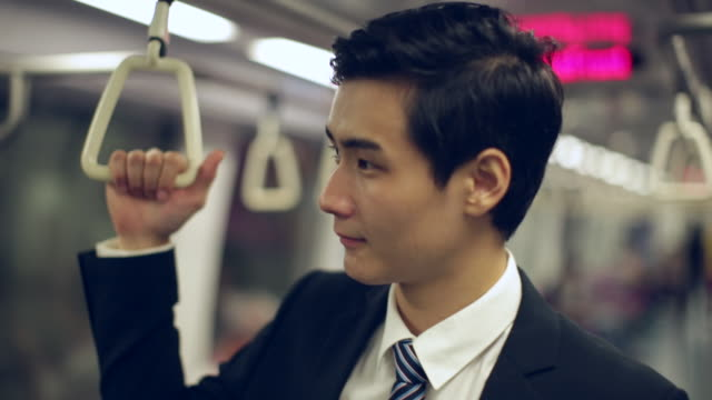 cu young businessman on subway train - business travel stock videos and b-roll footage
