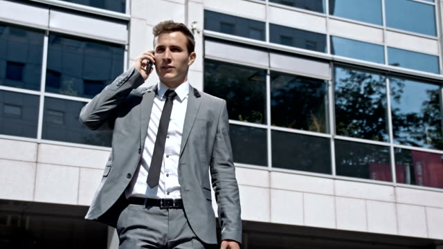 slo mo young businessman on the cell phone - formal businesswear stock videos & royalty-free footage