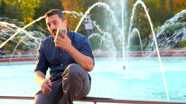 Young businessman talking on the phone outdoors