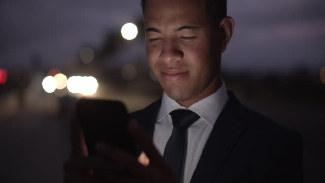 cu young businessman texting on his phone at night - full suit stock videos & royalty-free footage