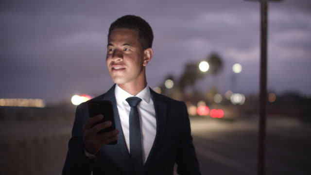 young businessman walking on the street at night - full suit stock videos & royalty-free footage