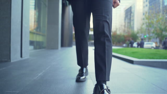 stockvideo's en b-roll-footage met a young businessman walking on the way to work - zakelijke kleding