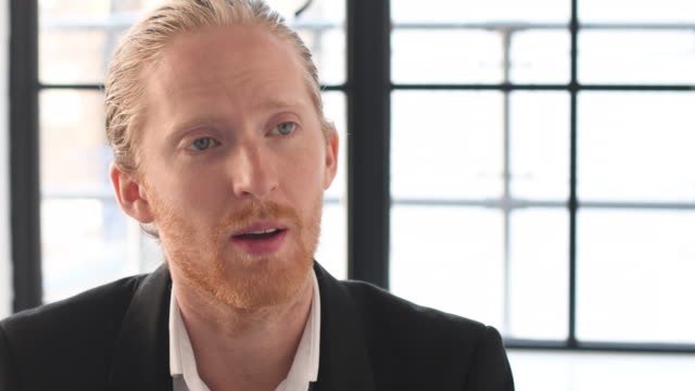 young businessman with red hair and beard talking to colleague - hair back stock videos & royalty-free footage