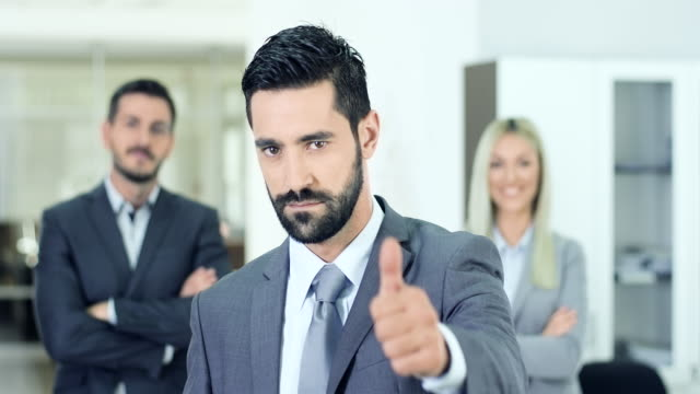 young businessman with thumbs up - ok stock videos & royalty-free footage